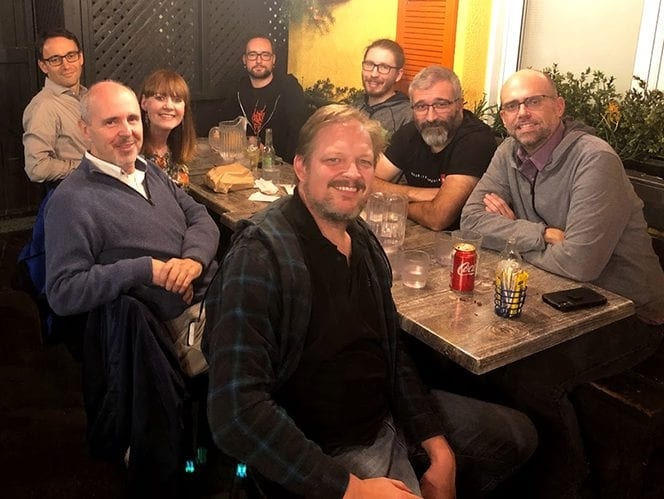Enjoying some Montreal poutine at the end of a hard day brainstorming at our XLOC Summit in 2019. (Front, L-R) Roberto Lambiase, Jenny McKearney, Fabio Minazzi and Mason Deming. (Back, L-R) Sebastian Maeser, Arseniy Politov, Paolo Pirocchi and Carlos Garcia-Shelton